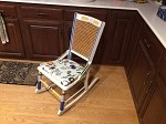 Antique rocker with caned back